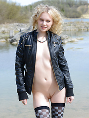 Hot curvy blonde teen sunbaths after doing a fantastic strip and tease show with her flawless slim body in a lake. - Erotic and nude girls pics at SoloTeenPics.com