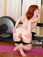 Adorable redhead gets some naughty pleasure after a workout - Erotic and nude girls pics at SoloTeenPics.com