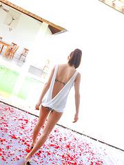 Saki Yamaguchi Asian spoils leering body in water with petals
