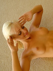 Lacey spreads her shaved pussy wide