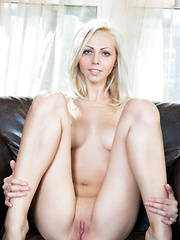 Sultry and confident blonde babe Lija makes a hot debut, surprising viewers with her amazingly athletic body with round, cuppable breasts, and long, flexible legs.