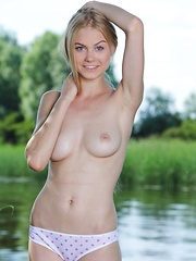 With her pretty girl-next-door allure, Nancy A is a delightfully refreshing view as she enthusiastically poses by the lake, showcasing her beautiful nubile body.