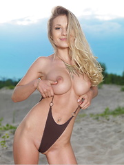 Candice B exudes a captivating nymph sprawled naked on the sandy shore, her slender, athletic body with round, cuppable breasts, slim waist, curvy hips, enviable long legs on full display. - Erotic and nude girls pics at SoloTeenPics.com