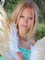 Amazing blonde teen babe gets naked on the lap of nature and tries to mimic some angelic beauty with her poses. - Erotic and nude girls pics at SoloTeenPics.com