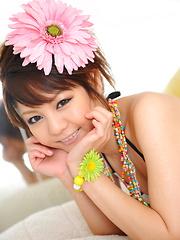 Hot dark haired Japanese babe shows her body