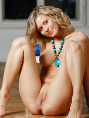 Olivvia A smiles enticingly as she cups her round, puffy breasts before posing confidently before Alex Sironi\'s camera. - Erotic and nude girls pics at SoloTeenPics.com