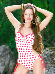 Mika A shows off her knockout body in and out of her teeny polka dot bathing suit.