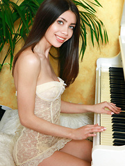 Flora C gently caresses her fingers down the piano, posing in her see-through, yellow babydoll before she slips out of it to reveal her delightful breasts, tiny waist, and her heavenly little pussy. - Erotic and nude girls pics at SoloTeenPics.com