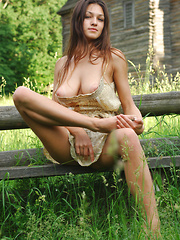 Sofi A teases her amazing breasts out of her little dress in a field of beautiful green grass. - Erotic and nude girls pics at SoloTeenPics.com