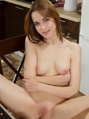Skinny brunette throws her skirt on the floor before she serves a nice slice of pink pussy in the kitchen. - Erotic and nude girls pics at SoloTeenPics.com