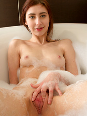 Stunning coed gets hot and horny in the tub fingering her pussy - Erotic and nude girls pics at SoloTeenPics.com