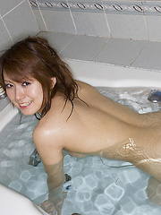 Rin Hitomi Asian shows nasty ass and spoils fresh tits with water - Erotic and nude girls pics at SoloTeenPics.com