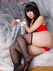 Rin Yoshino Asian is erotic bunny in black and red lingerie